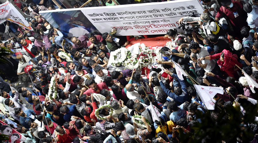 Democratic Youth Federation of India members take part in the funeral procession of Maidul Islam Middya in front of the party office, in Calcutta on Monday, Feb. 15, 2021.