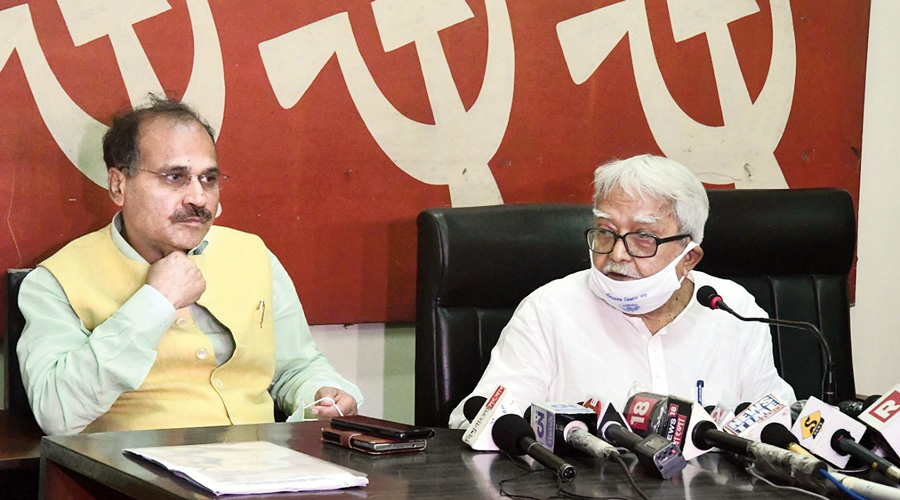 (Left) Adhir Ranjan Chowdhury and Biman Bose at the CPM state headquarters in Calcutta on Tuesday.