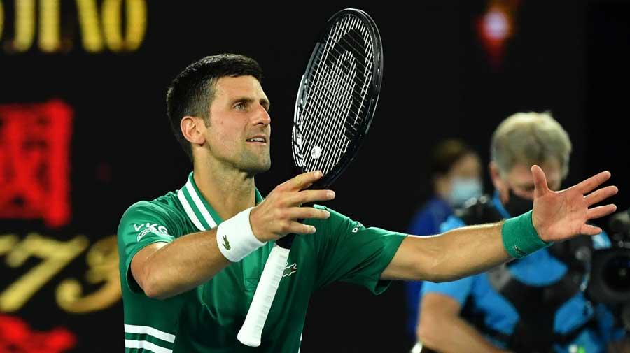 Novak Djokovic exults after his victory.