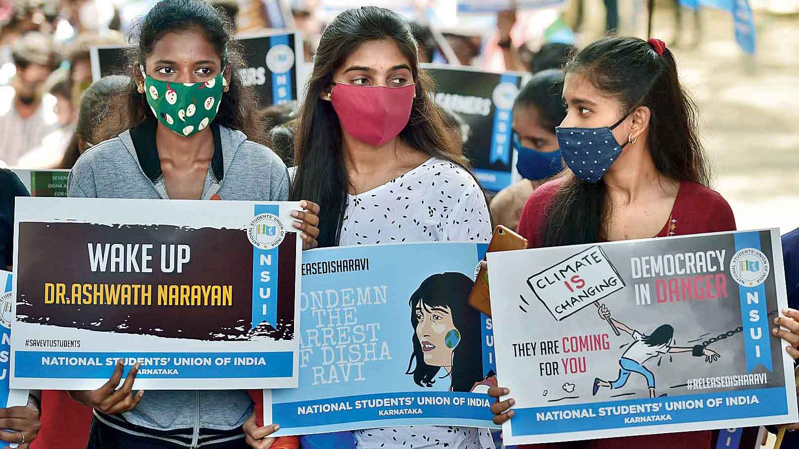 Students and members of NSUI protest against Disha's arrest in Bangalore on Tuesday.