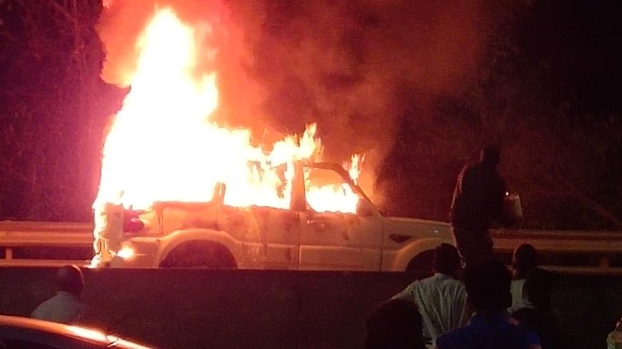The SUV up in flames on the Marine Drive in Sonari on Tuesday night.