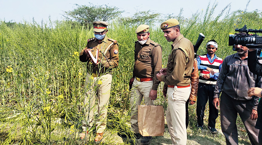 Police on Thursday at the site where the girls were found  in Unnao district.