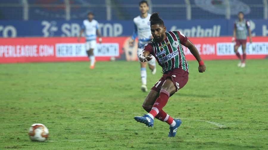 ATK Mohun Bagan's Roy Krishna beats SC East Bengal's goalkeeper Subrata Paul to score on Friday.