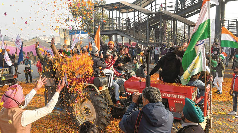 Flower petals being showered on farmers riding on their tractors after breaking the police barricades at Singhu border during the 'Kisan Gantantra Parade' on Republic Day, in New Delhi, Tuesday, Jan. 26, 2021.