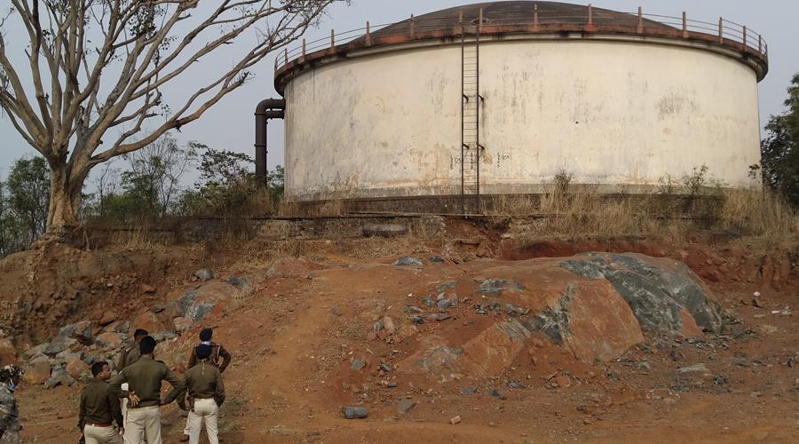 Policemen near the water tank in Adityapur, Jamshedpur on Saturday.