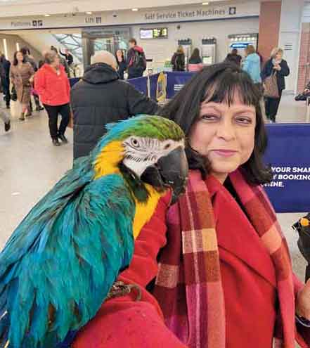 Bashabi with a colourful feathered friend in her current home town Edinburgh