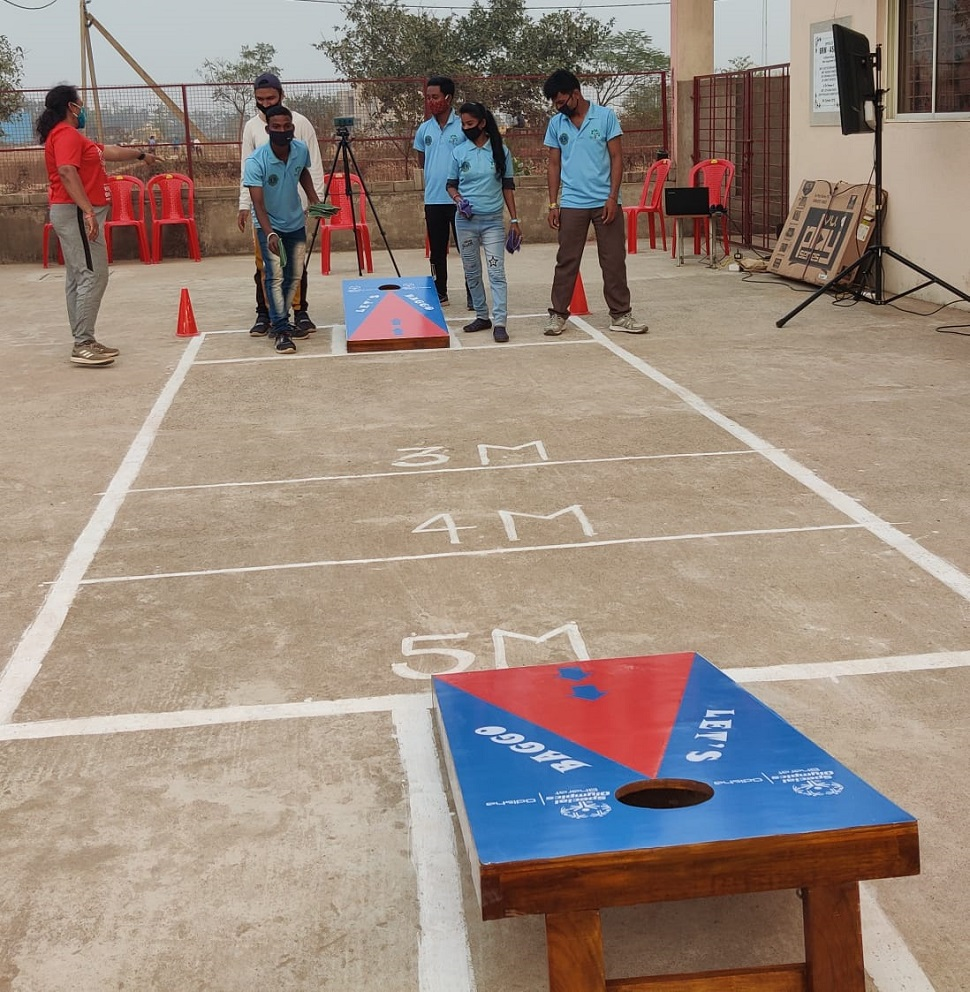 Special athletes play Cornhole Baggo in Odisha.