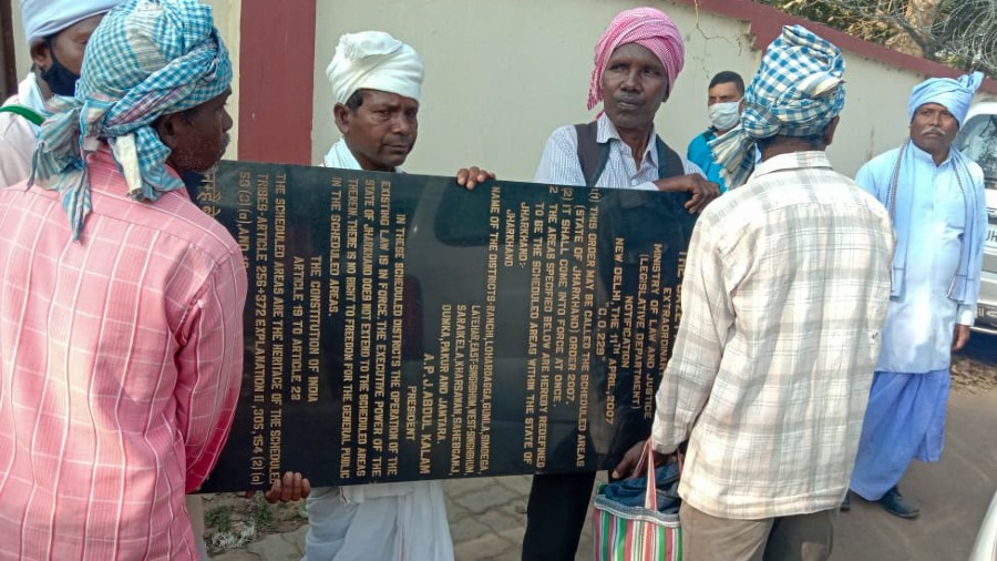 Protesters with the plaque that they  tried to install near Jharkhand High Court in Ranchi on Monday