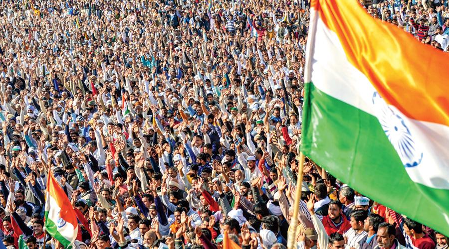 Farmers holding the national flag attend the Kisan Mahapanchayat in Uttar Pradesh's Shamli district on February 5.