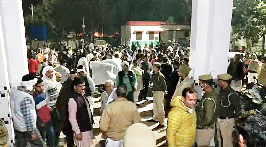 Farmers outside the Shahpur police station seeking  action against Balyan.