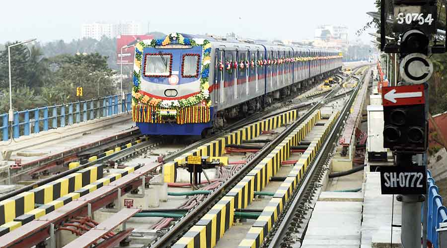 A Metro train leaves Dakshineswar station after the flag-off on Monday.
