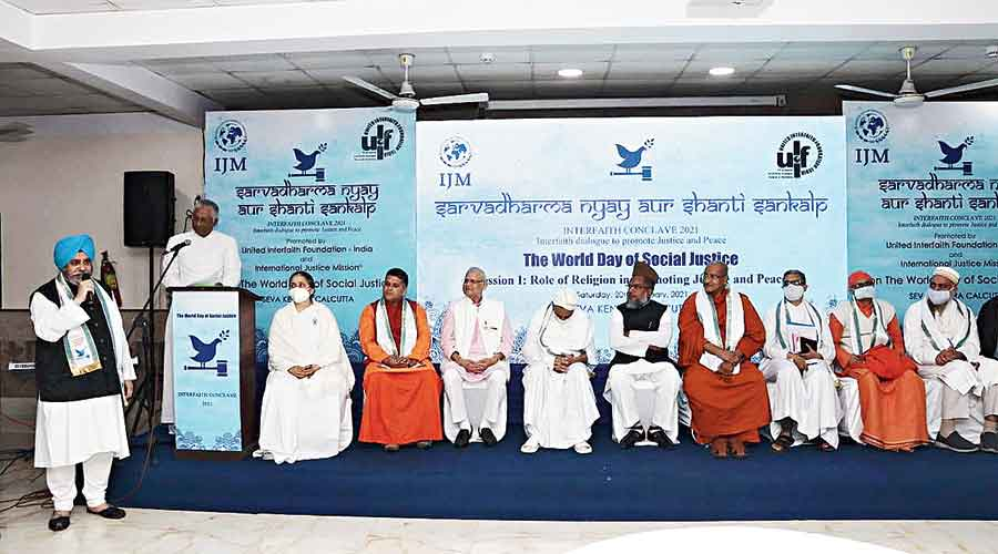 Religious leaders and community heads at the interfaith conclave on Saturday