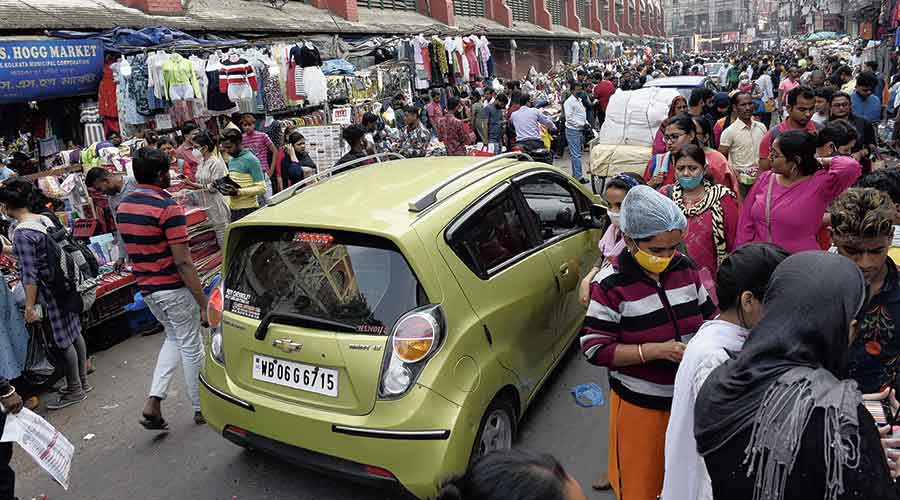 A car stuck in the New Market area as most of the road is occupied by hawkers.