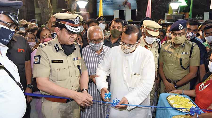 Calcutta police commissioner Soumen Mitra (left) with  state minister Aroop Biswas at the inauguration of  Golf Green police station on Monday. Special commissioner Debasish Roy (right) was also present