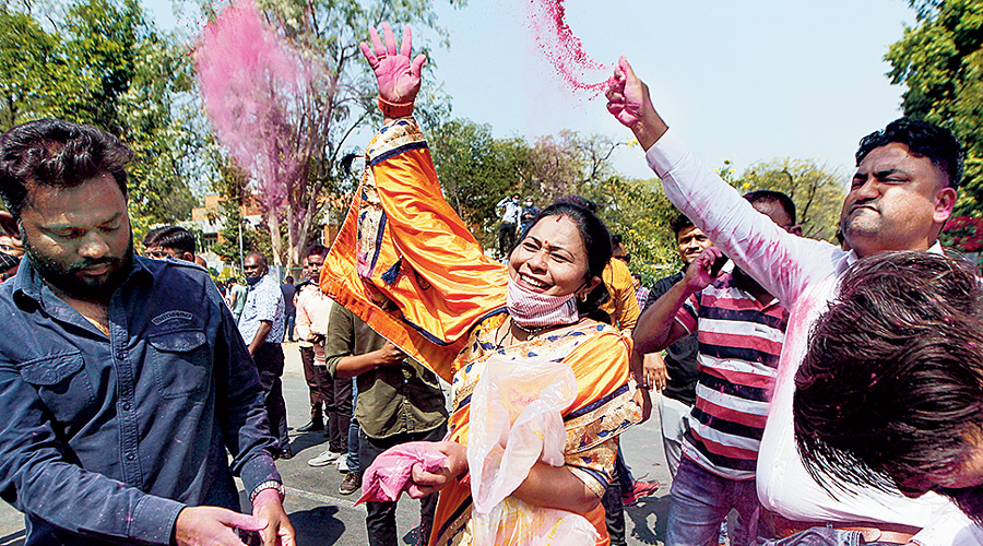 BJP workers and supporters celebrate in Ahmedabad on Tuesday.