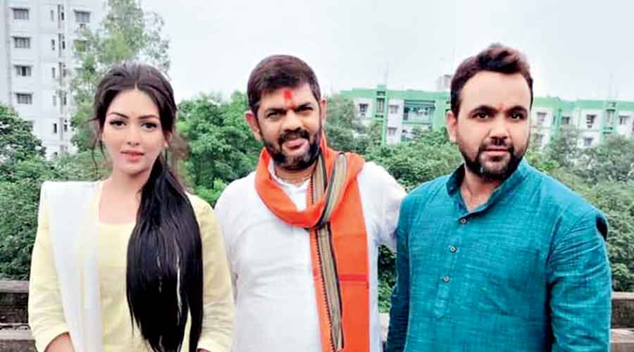 (From left) BJP leaders Pamela Goswami, Rakesh Singh and Prabir Kumar Dey.  Dey, Goswami's friend, had been arrested with her last Friday