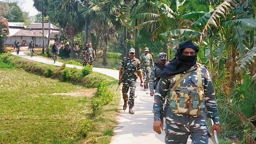 Police and paramilitary personnel patrol a village in East Midnapore on Tuesday