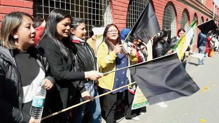 Women members of the Morcha's Gurung faction with black flags near the Darjeeling railway station on Tuesday