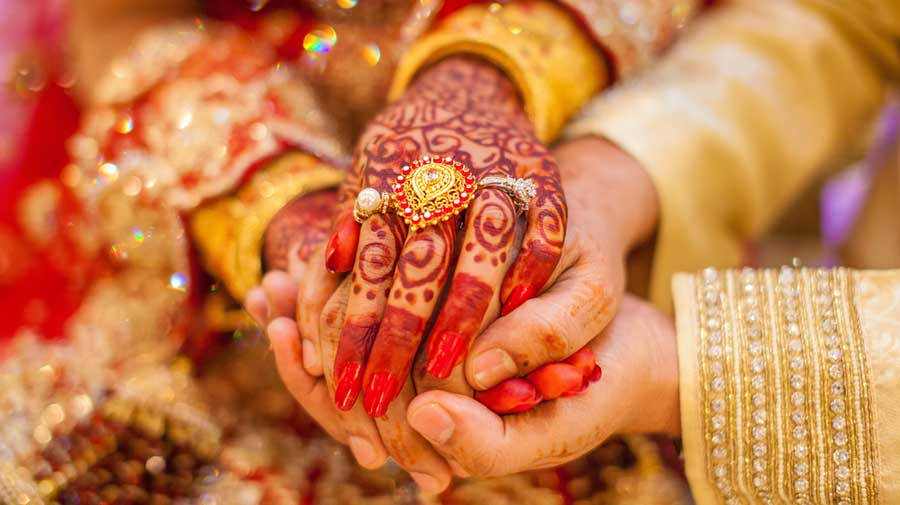 According to the revised guidelines, the bridegroom and the bride must have completed 21 years and 18 years of age, respectively, at the time of marriage.
