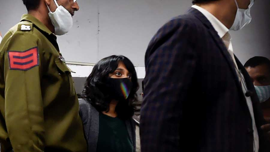 Disha Ravi leaves Patiala House Court after a hearing in a toolkit case in New Delhi on Tuesday.