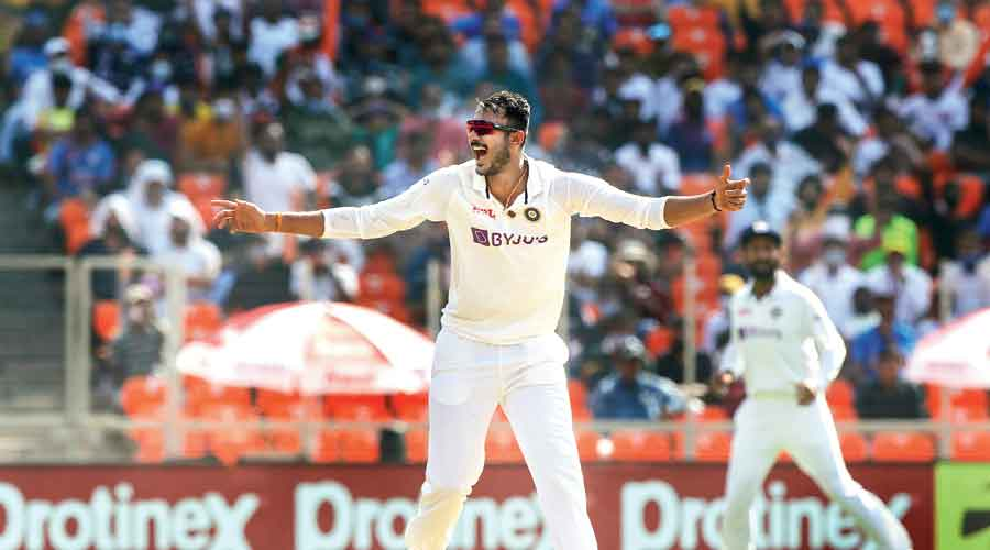 Axar Patel celebrates after trapping Zak Crawley leg before —  one of his six wickets in England's first innings in the third Test at Ahmedabad on Wednesday. Axar, who bagged 5/60 in the second innings of his Test debut in the previous match in Chennai, thus becomes the third Indian after Mohammad Nissar and Narendra Hirwani to take a five-for in his first two Test matches