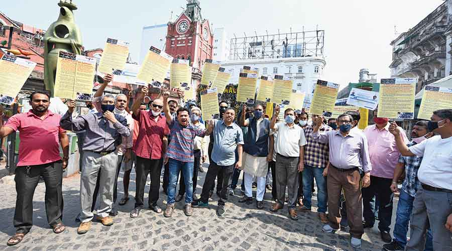 Traders in the New Market area protest on Wednesday against encroachment of roads by hawkers in the shopping hub.