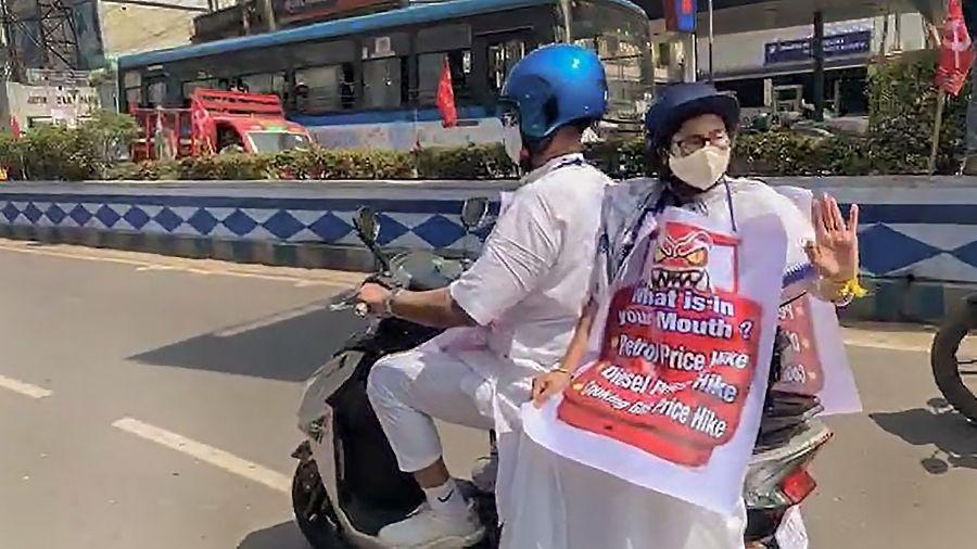 Mamata Banerjee rides  an e-scooter to reach the secretariat, in Calcutta on Thursday.
