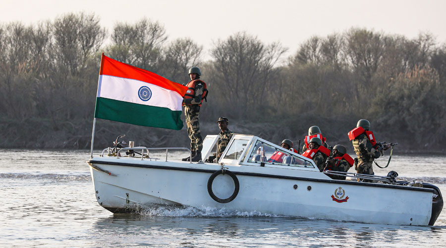 BSF personnel patrol in a boat at River Chenab along the International border in Akhnoor sector of Jammu on Thursday, Feb. 25, 2021.