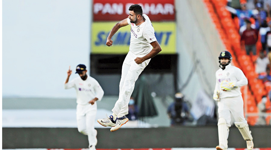 Ravichandran Ashwin jumps in joy at the dismissal of Ollie Pope in England's second innings on Thursday. Jofra Archer became the  off-spinner's 400th Test victim.