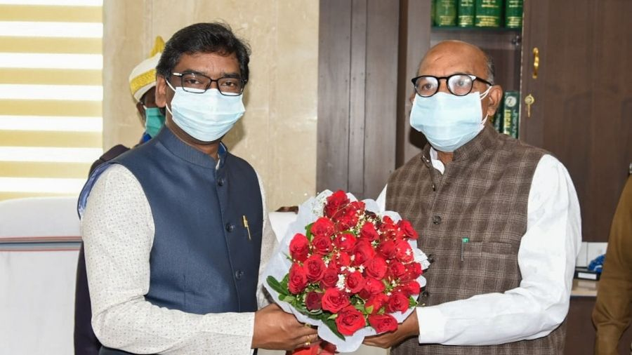 Chief minister Hemant Soren presents the customary bouquet to Speaker Rabindranath Mahato at his chamber in the Assembly on the first of the Budget session in Ranchi on Friday.