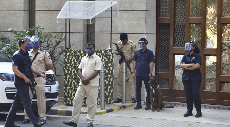 Police personnel guard outside industrialist Mukesh Ambanis residence Antilla, a day after explosives were found in an abandoned car in its vicinity, in Mumbai on Friday.