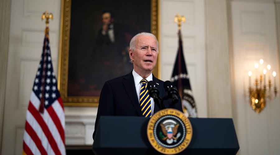 President Joe Biden talks during an executive order signing ceremony at the White House in Washington on Wednesday