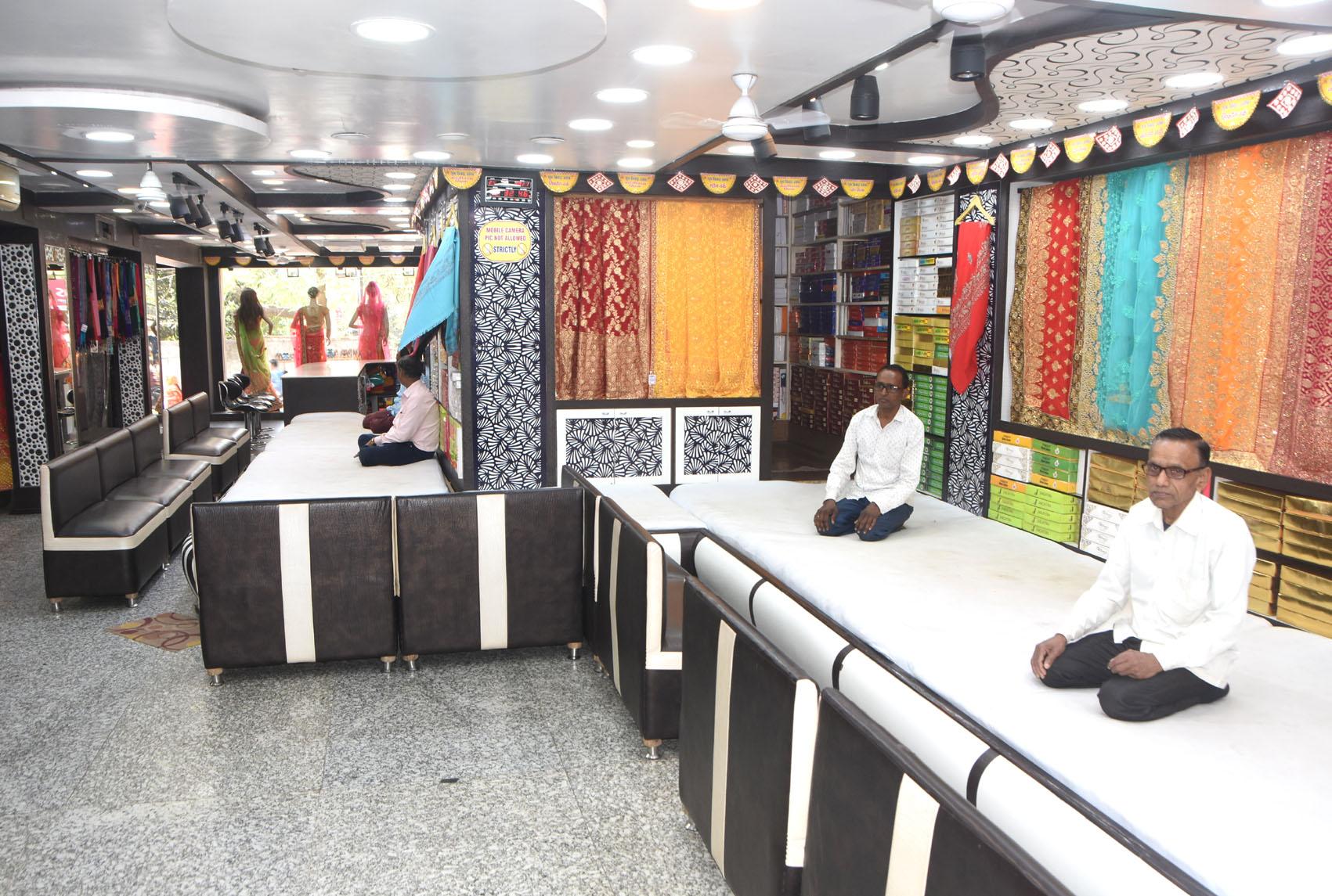 A sari shop awaits customers at Hirapur Park Market in Dhanbad on Thursday.