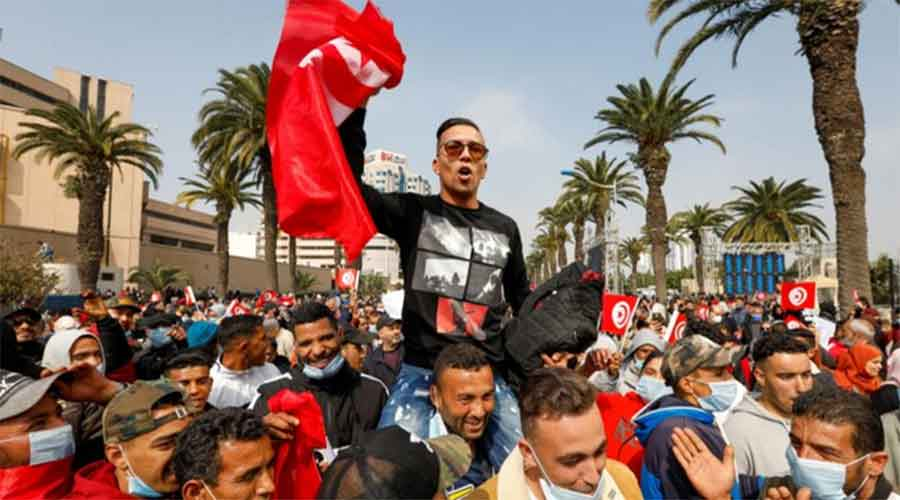 """Tens of thousands of Ennahda supporters marched through central Tunis chanting, """"The people want to protect institutions!"""" and """"The people want national unity!"""""""