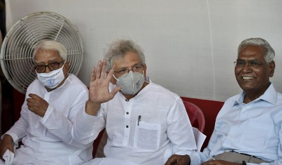 Left Front Chairman Biman Bose, General Secretary of the Communist Party of India (Marxist) Sitaram Yechury and General Secretary of the CPI D Raja during Left-Congress and Indian Secular Front (ISF) joint rally, ahead of West Bengal assembly polls, in Kolkata, Sunday