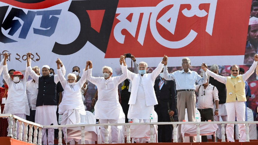 Left Front Chairman Biman Bose, CPI(M) General Secretary Sitaram Yechury, CPI General Secretary D Raja, Chhattisgarh CM Bhupesh Baghel, Senior Congress leader Adhir Ranjan Chowdhury and other leaders join hands during the joint rally of Left, Congress and Indian Secular Front (ISF), ahead of West Bengal assembly polls, in Kolkata, Sunday