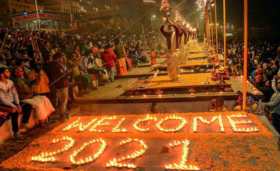 Priests perform Ganga Aarti as people prepare to welcome the New Year 2021, in Varanasi on Thursday.