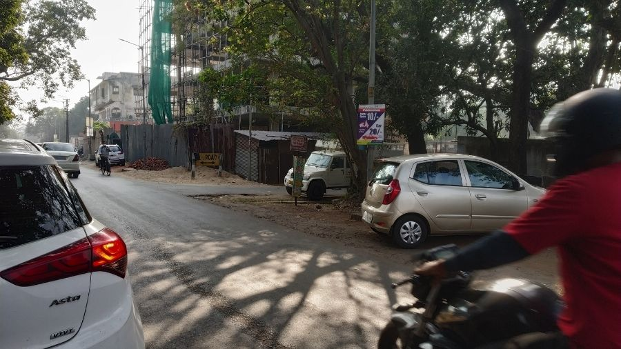 The JNAC fixes boards notifying parking charges in the residential area at Bistupur, Jamshedpur on Saturday.