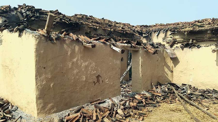 The torched house of the couple with the alleged Maoist link at Manatu in Palamau on Friday night.