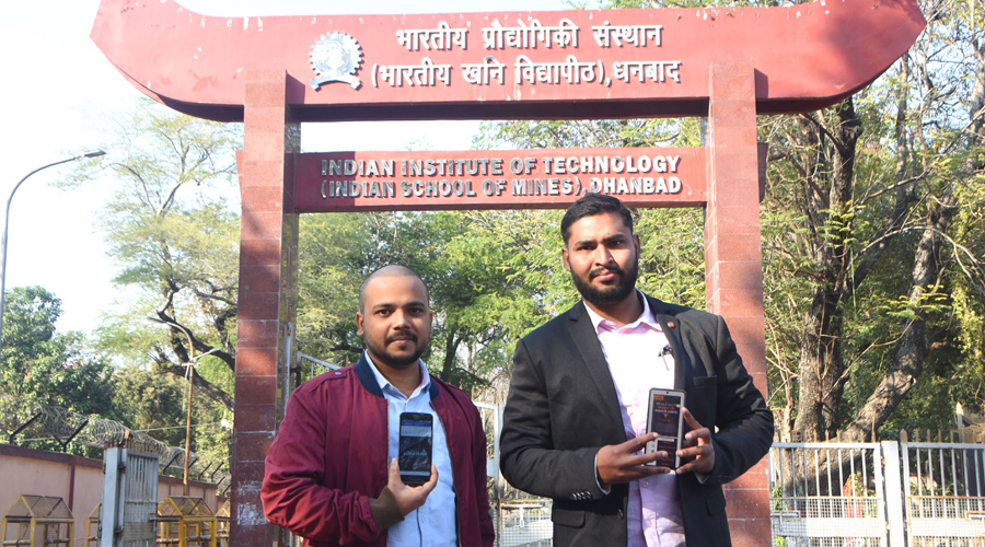 IIT (ISM) Dhanbad Techies, Ashish Kumar (in coat) (2018 batch pass out) and Ashish Ranjan (in red jacket) (2019 batch pass out) showing their app pages in Dhanbad on Sunday.