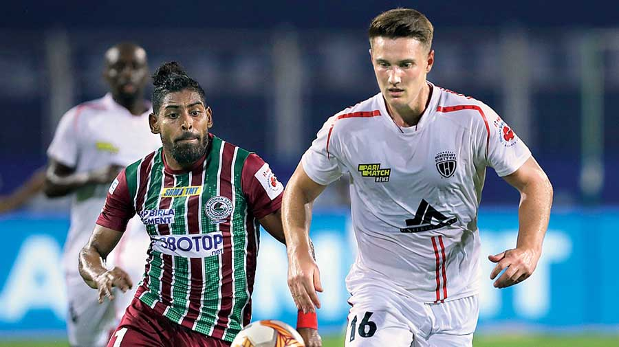 ATK Mohun Bagan's Roy Krishna vies for the ball with an opponent in Margao on Sunday.