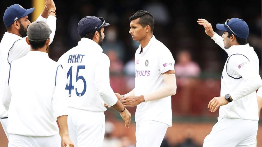 Indians celebrate an Australian wicket in Sydney on Thursday