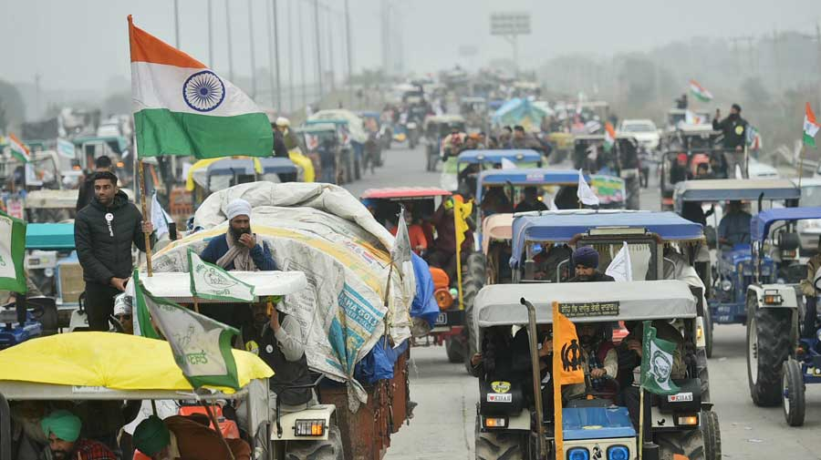 Farmers on their way to Tikri border during a tractor rally as part of their protest against the new farm laws, at Western Peripheral Expressway in Kundli, Sonipat, on Thursday.