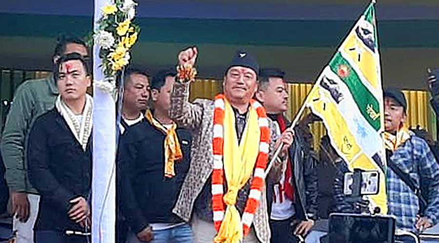 Bimal Gurung with a Gorkha Janmukti Morcha flag at the public meeting in Kalimpong on Thursday.