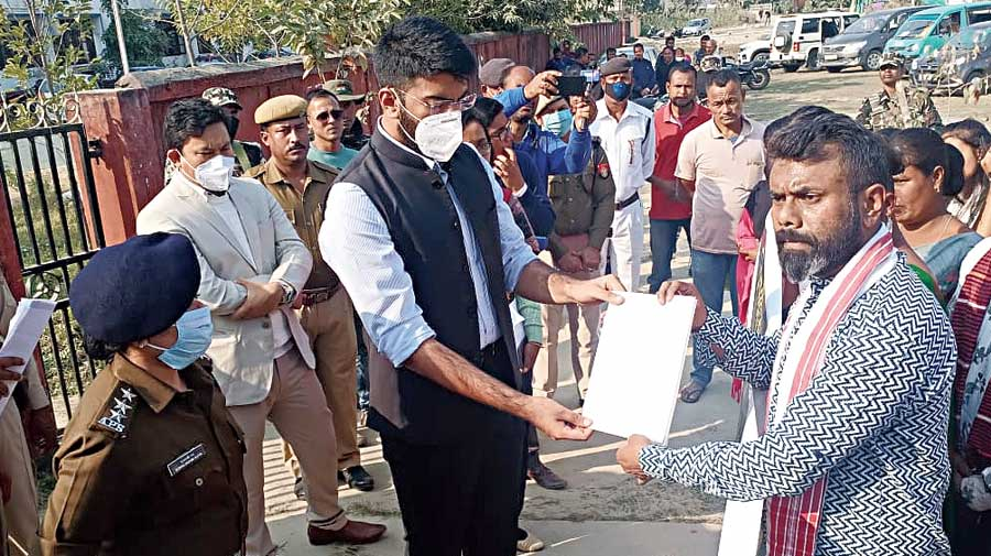 SDO (Civil) Aditya Vikram Yadav  receives a memorandum from senior Congress MLA Rupjyoti Kurmi (in gamocha) after the protest at Gohpur on Wednesday