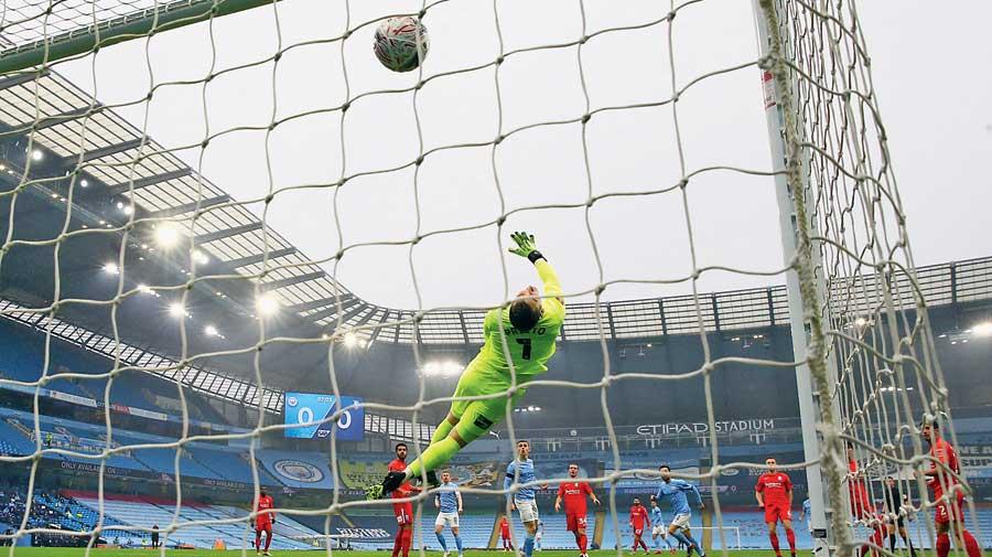 Bernardo Silva of Manchester City scores past Andres Prieto of Birmingham City at the Etihad Stadium on Sunday.