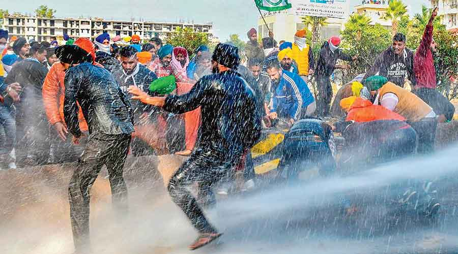 Police use water cannons to disperse protesting farmers  at Kaimla village in Karnal, Haryana, on Sunday. The protests forced a helicopter carrying chief minister and  BJP leader Manohar Lal Khattar to turn back  without landing.
