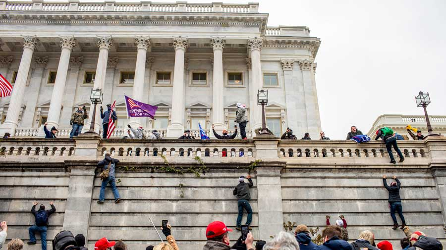 Supporters of Donald Trump climb the walls of the US Capitol on Wednesday. The vandalism that followed had no parallel in modern American history.
