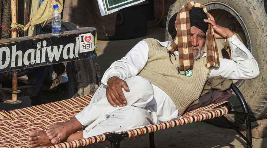 A farmer takes rest  at Singhu border
