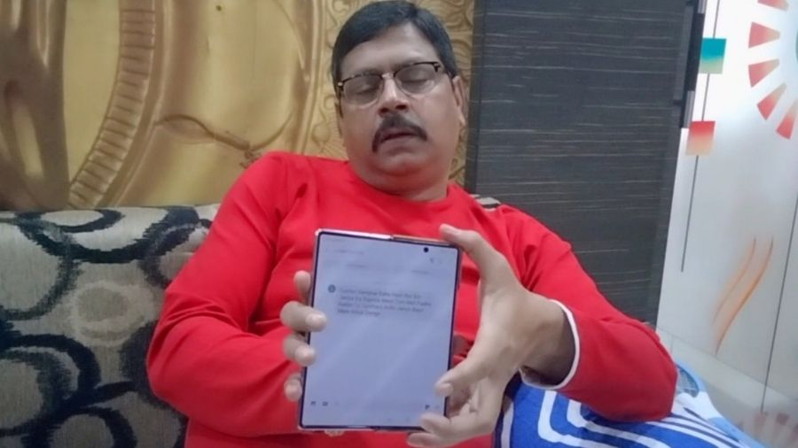 Santosh Singh shows the threat message on his phone, at his house in Dhaiya, Dhanbad, on Tuesday.